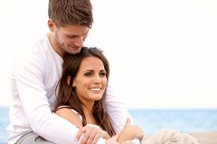 Couple Hanging Out by the Sea royalty free stock image