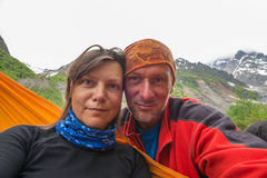 Couple of happy adventurers taking selfie in the mountains Royalty Free Stock Image