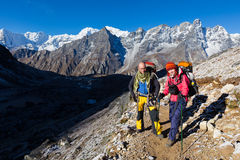 Couple happy backpackers standing  Himalaya snow trail. Royalty Free Stock Photo