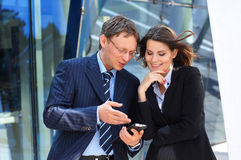 A couple of happy business persons working Stock Images