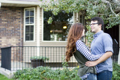 Couple happy in front of  new home Royalty Free Stock Photography
