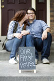 Couple happy in front of  new home Royalty Free Stock Photos