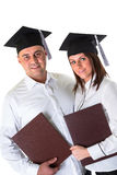 Couple of happy graduating students Royalty Free Stock Photos