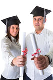 Couple of happy graduating students Stock Photos