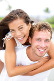 Couple happy having fun piggybacking Stock Photography