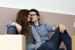 Couple happy inside new home with boxes Stock Photo