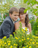 Couple happy in love sitting in the park Royalty Free Stock Photography