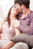 Couple of happy lovers smiling eachother Stock Image