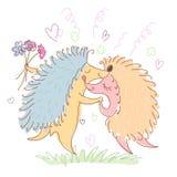 Couple of happy loving hedgehogs. Stock Photo