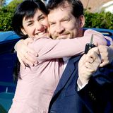 Couple happy about new car smiling Royalty Free Stock Photography