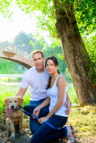 Couple happy posing with golden retirever dog Royalty Free Stock Photos