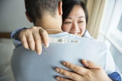 A couple happy about pregnancy test result Stock Images