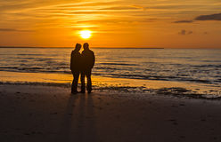 Couple of happy seniors at a beach of the Baltic Sea during sunset Royalty Free Stock Image