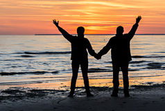 Couple of happy seniors at a beach of the Baltic Sea during sunset Royalty Free Stock Photos
