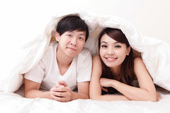 Couple happy smile in bed Royalty Free Stock Image