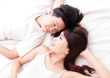 Couple happy smile looking to each other in bed Stock Image