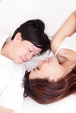 Couple happy smile looking to each other in bed Stock Images