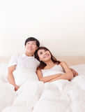 Couple happy smile looking to empty copy space in bed Royalty Free Stock Photos