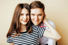 Couple of happy smiling teenagers students, warm colors having a Royalty Free Stock Images