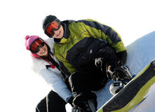 Couple of happy snowboarders royalty free stock photography