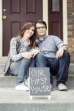 Couple happy staring at new home purchase Royalty Free Stock Images