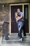 Couple happy staring at new home purchase Stock Image