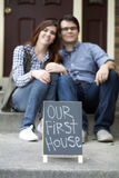 Couple happy staring at new home purchase Stock Photography