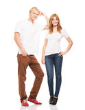 Couple of happy teenagers posing isolated on white Royalty Free Stock Photography
