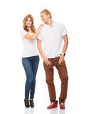 Couple of happy teenagers posing isolated on white Royalty Free Stock Photo