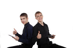 Couple of happy teenagers with tablet computer Stock Photo