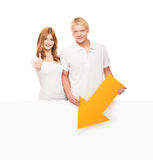 Couple of happy teenagers with a white blank banner Stock Photography