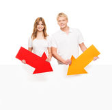 Couple of happy teenagers with a white blank banner Stock Photo