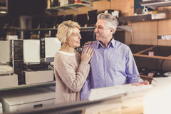 Couple are happy together in household appliances shop. Mature family couple are happy together in household appliances shop Stock Images