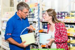 Couple in hardware store arguing about color of paint for renovating Stock Photography