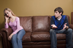 A couple has an argument on the couch Royalty Free Stock Image