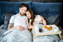Couple has breakfast in bed Royalty Free Stock Photos