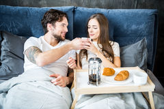 Couple has breakfast in bed Stock Photos