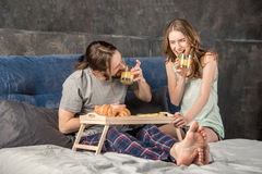 Couple has breakfast in bed Stock Image
