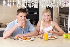 Couple has breakfast in the kitchen Royalty Free Stock Images