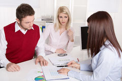 Couple has consultation with consultant at office. Stock Images