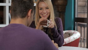 Couple has a date at the cafe stock footage