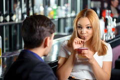 Couple has a drink in bar Royalty Free Stock Photography