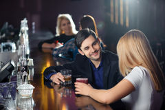 Couple has a drink in bar Royalty Free Stock Images