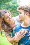 Couple has fun in the park. Young couple has fun in the park Stock Photos