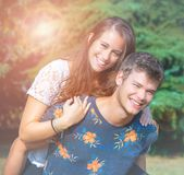 Couple has fun in the park. Young couple has fun in the park Stock Images
