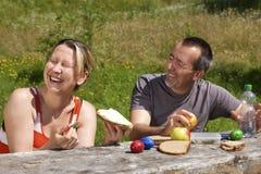 Couple has fun on picnics Royalty Free Stock Photos