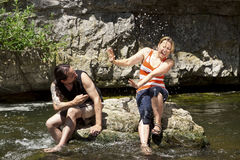 Couple has fun in the river Stock Photos