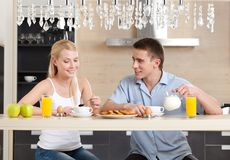 Couple has a snack in the kitchen Royalty Free Stock Image