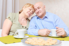 Couple has tea with biscuits Stock Image