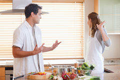 Couple has a tensed situation in the kitchen Stock Photo